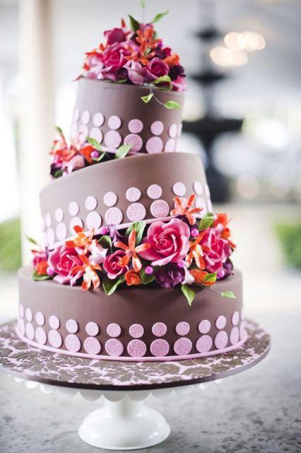 Colorful topsy turvy wedding cake