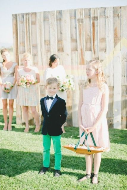 Creative look of a ring bearer with green pants