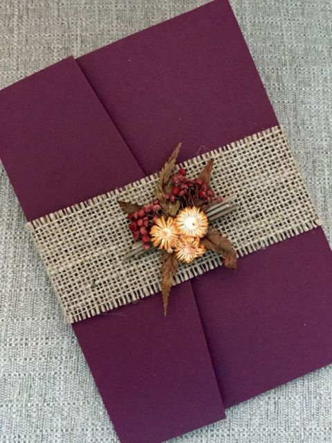 Elegant invitation wrapped by burlap ribbon