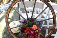 Floral wagon wheel for wedding decor