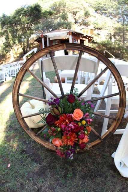 Floral wagon wheel for wedding decor