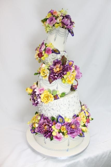 Four tiered topsy turvy wedding cake