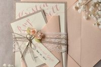 Gorgeous wedding invitation decorated with lace and flower