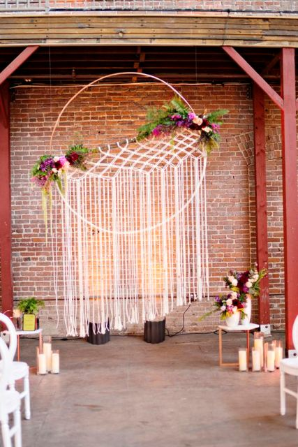 Macrame knotted wedding backdrop for indoor weddings