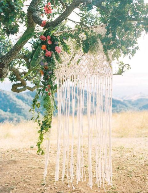 Macrame knotted wedding backdrop for outdoor weddings