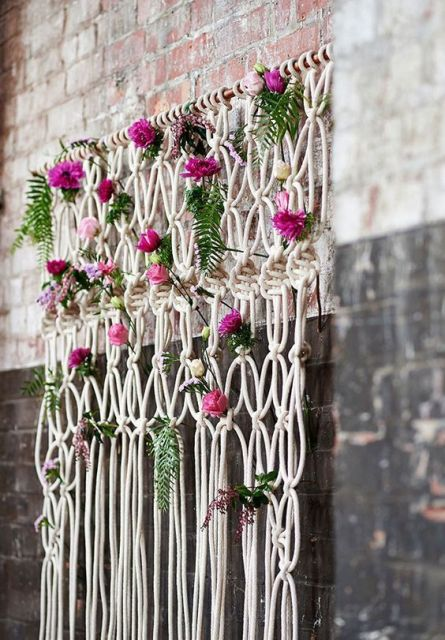 Macrame knotted wedding backdrop with flowers