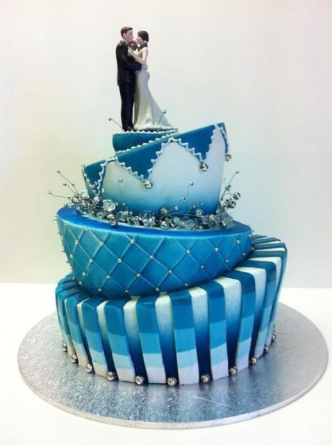 Topsy turvy wedding cake in blue shades