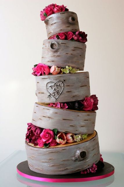 Topsy turvy wedding cake with flowers