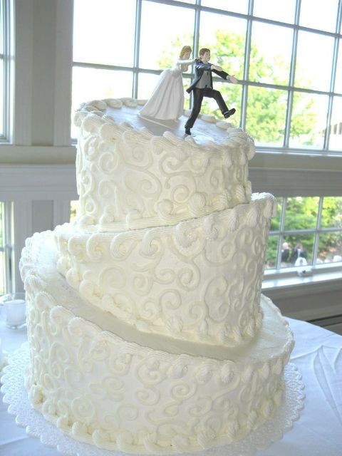 Topsy turvy wedding cake with funny cake topper