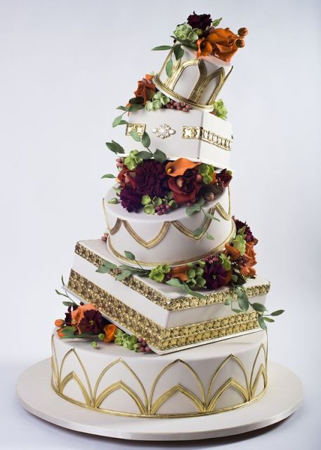 Topsy turvy wedding cake with gold print