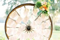 Wagon wheel as a display for escort cards