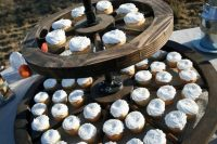 Wagon wheel as a stand for cupcakes