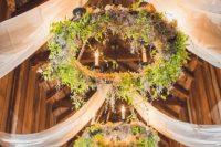 Wagon wheel hanging decor for wedddings