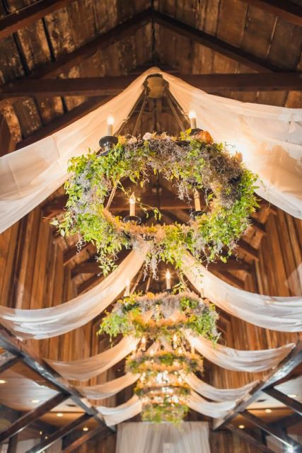 Wagon wheel hanging decor for wedddings