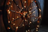 Wedding decor details with wagon wheel and lights
