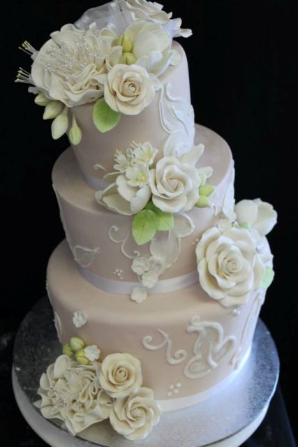 White topsy turvy wedding cake