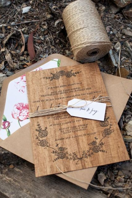 Wood wedding invitation wrapped by twine