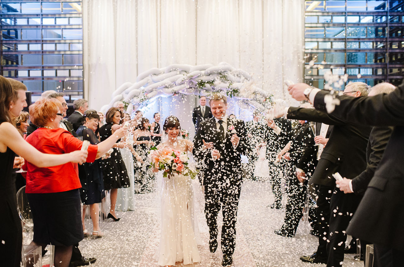Picture Of black and gold wedding filled with confetti and champagne  19