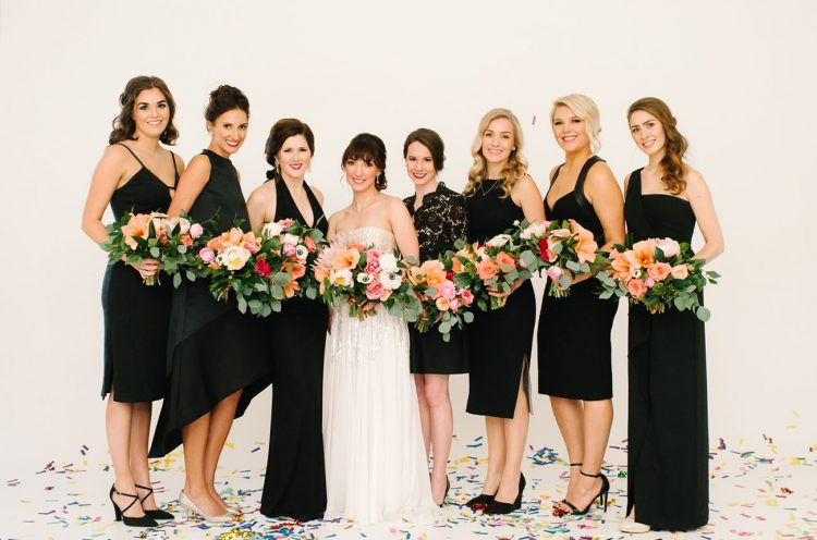 The bridesmaids in black highlighted the bride wearing a sequin gown