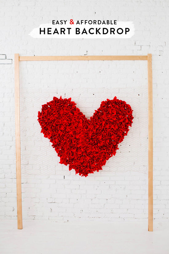 DIY red napkin heart backdrop (via designlovefest)