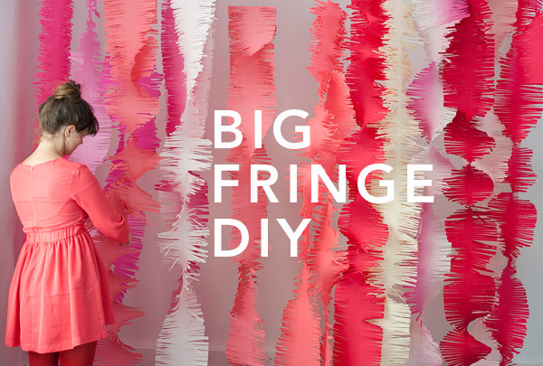 DIY big fringe garlands backdrop (via ohhappyday)