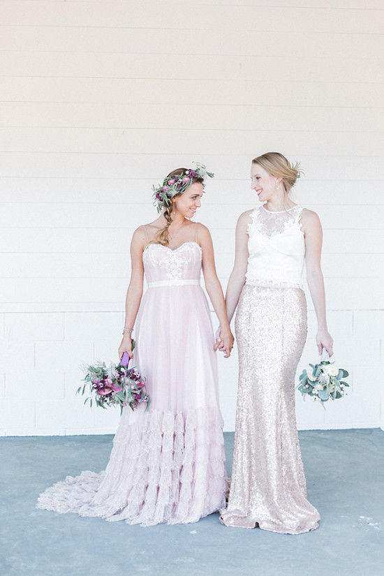 The second bride was wearing an off-white lace appliqué crop top with a fit and flare rose gold sequin skirt