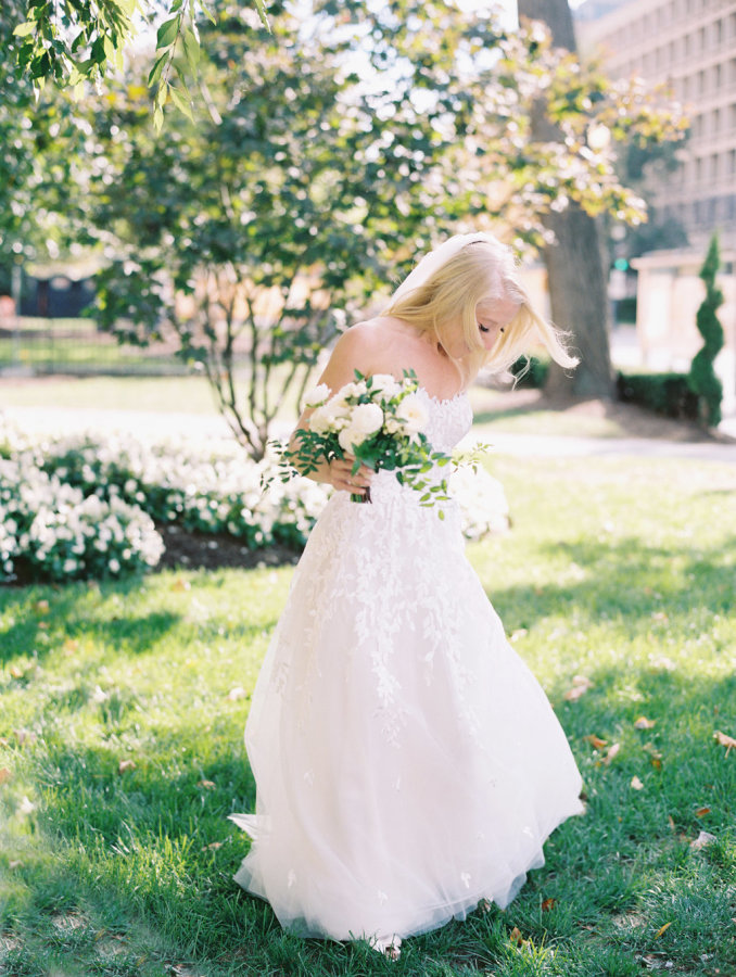 The gorgeous blond bride in her white dress was the only light 'spot' on that day