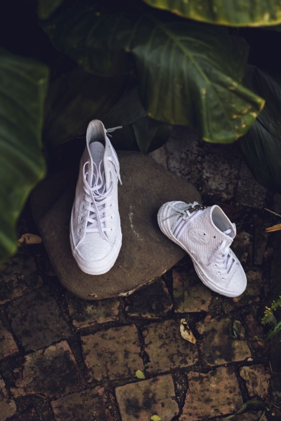 The groom gifted his bride a pair of white Converse for the wedding