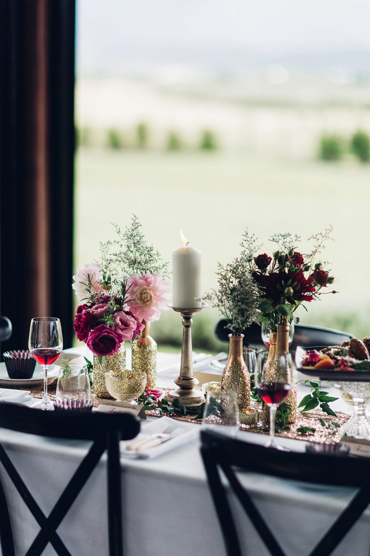 Gold-filled bottles and candles made the table setting more romantic