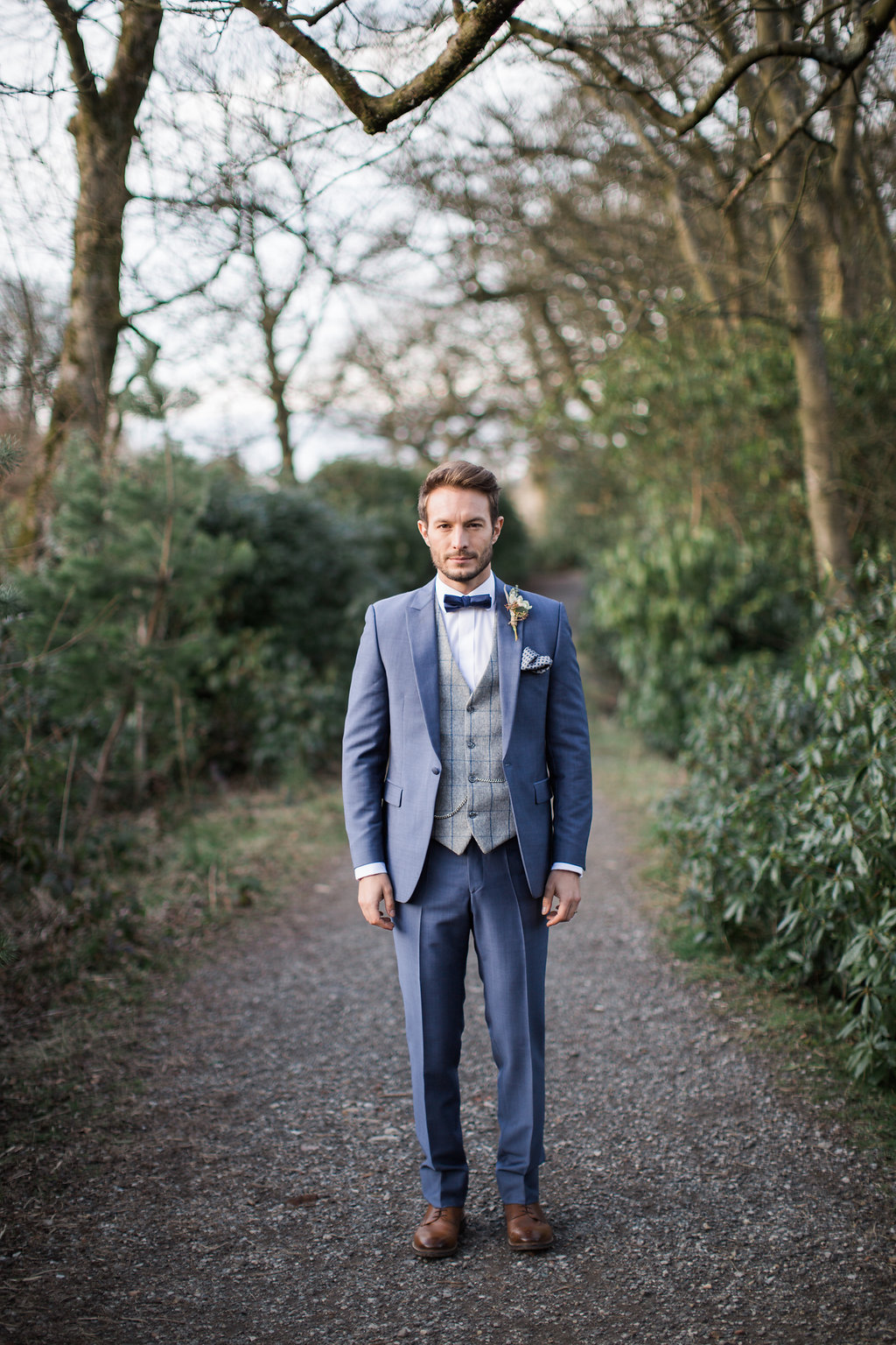 The groom rocked a cool blue suit as colored suits are a trend