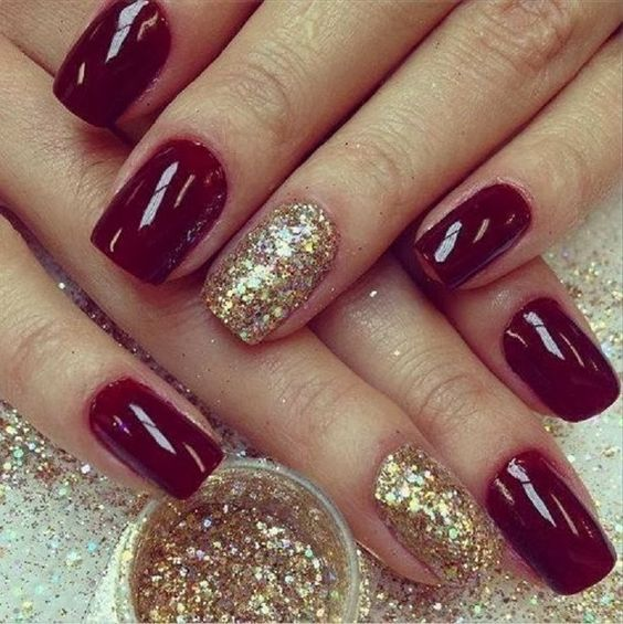 06 burgundy nails with a gold accent one