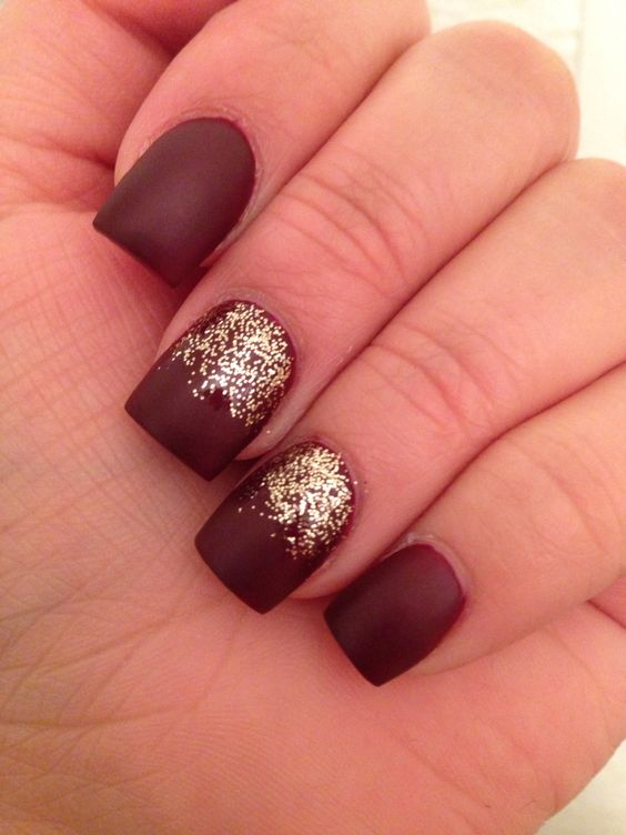 matte burgundy nails with gold glitter