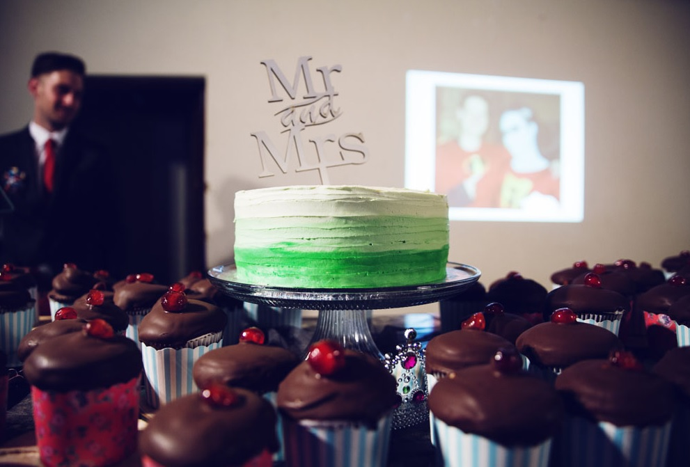 The cake was a bold green ombre one and the cupcakes were chocolate with red jelly