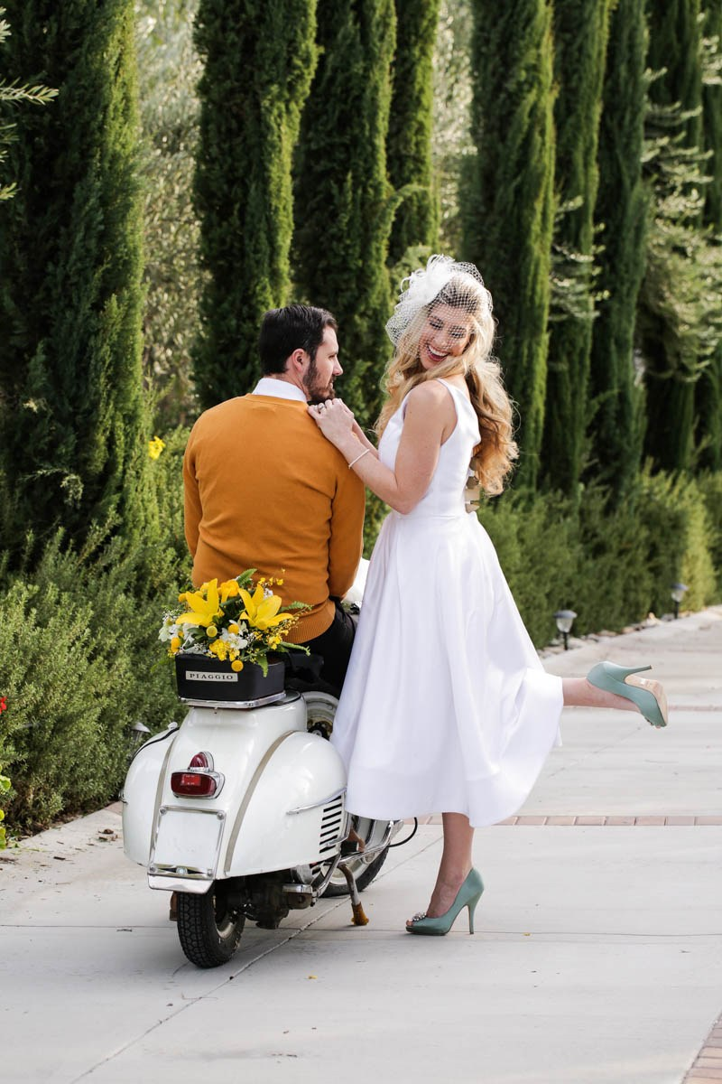 Vespa is a great idea for a memorable entrance or exit of the couple
