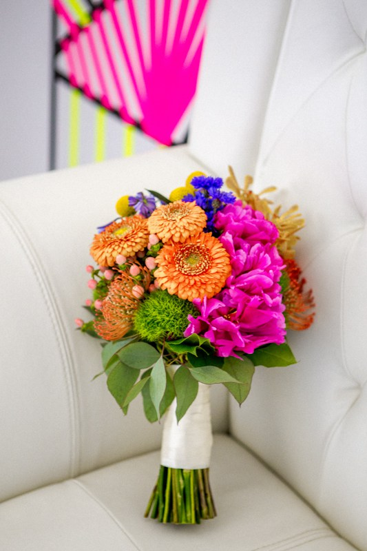 The bridal bouquet was done in the same bold and neon shades