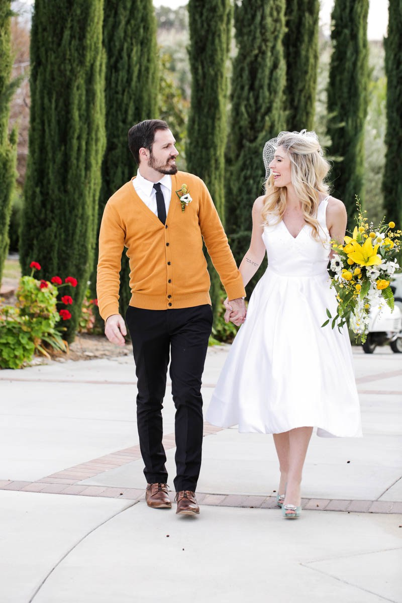 10 The groom added a yellow cardigan to his look to tie with the wedding colors