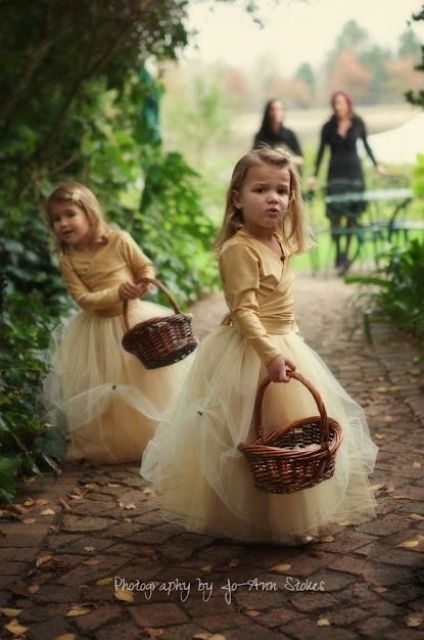 beige tutu skirts and cardigans to keep the girls warm