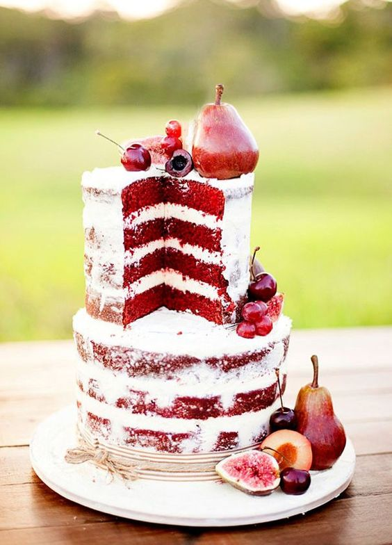 deep red fall wedding cake with pears, cherries and figs