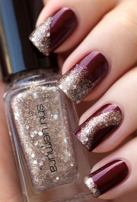 marsala manicure with gold glitter decor