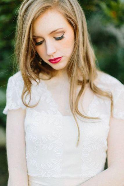 moody makeup with fuchsia lips
