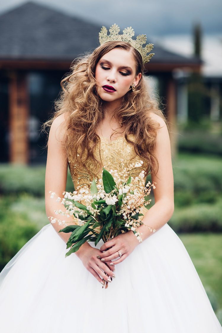 The gold bodice of this dress looked stunning with a crown