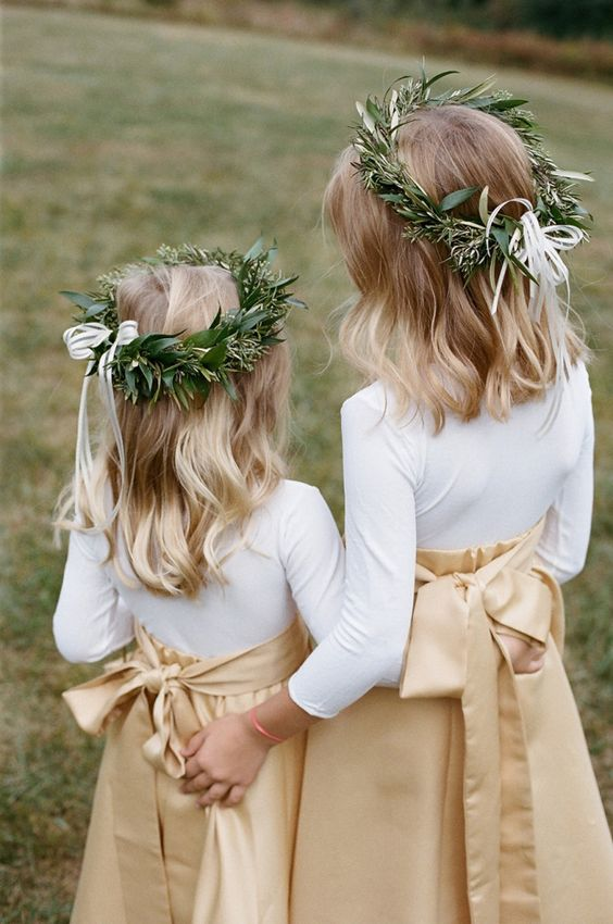 beige maxi skirts, white shirts and greenery crowns