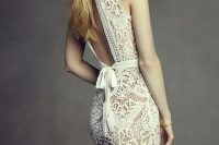 14 lace wedding dress with fringe and an open back