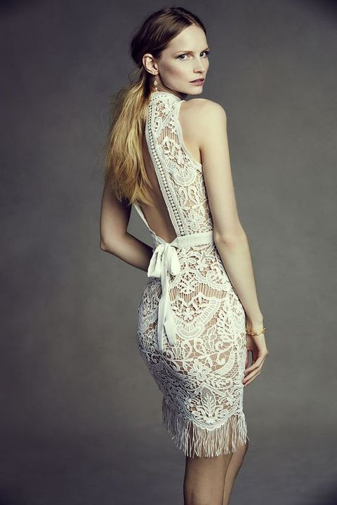 lace wedding dress with fringe and an open back