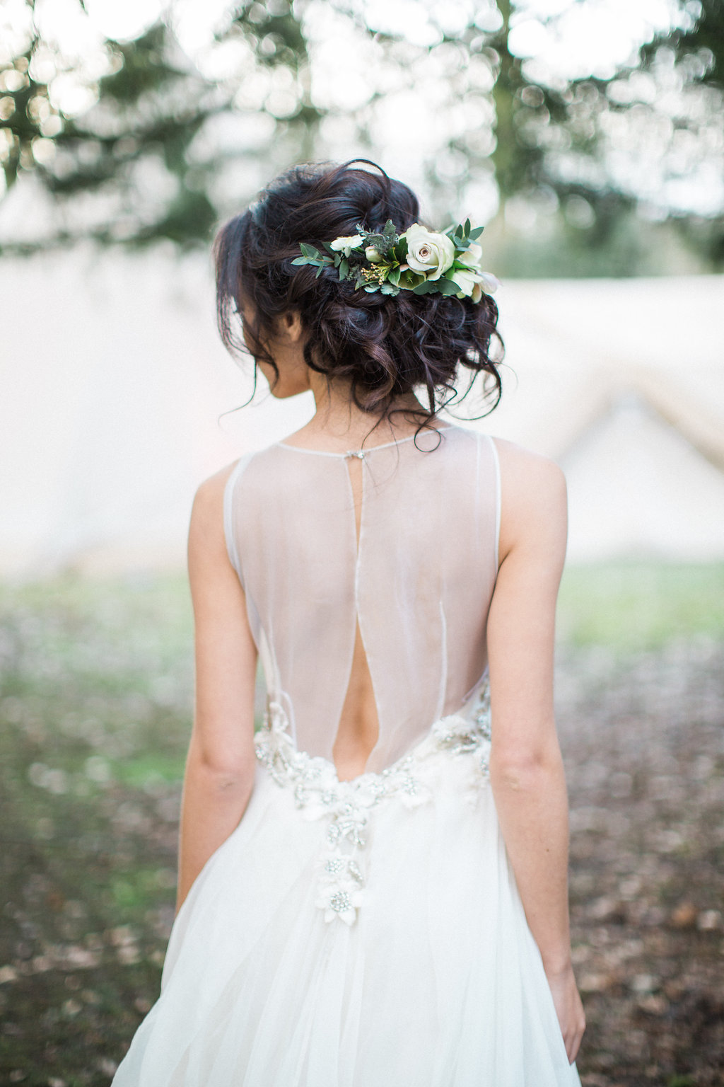 A messy updo looks great for a woodland wedding