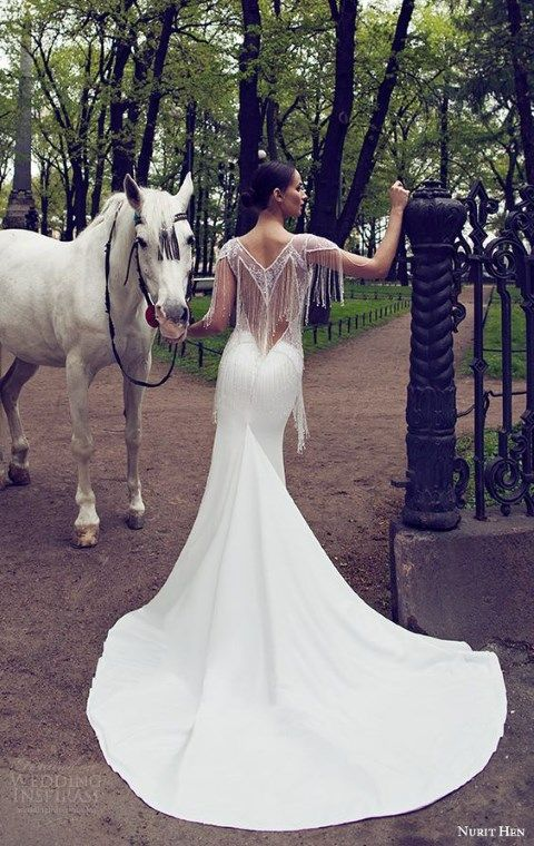 long plain wedding dress with a fringe back