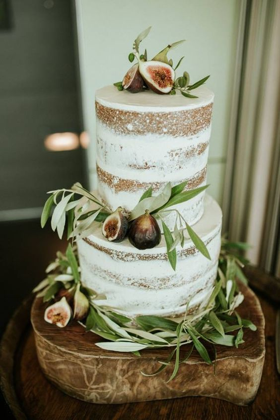 naked fall wedding cake decorated with figs