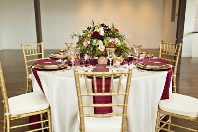 Burgundy, Gold And White Table Setting For A Fall Wedding