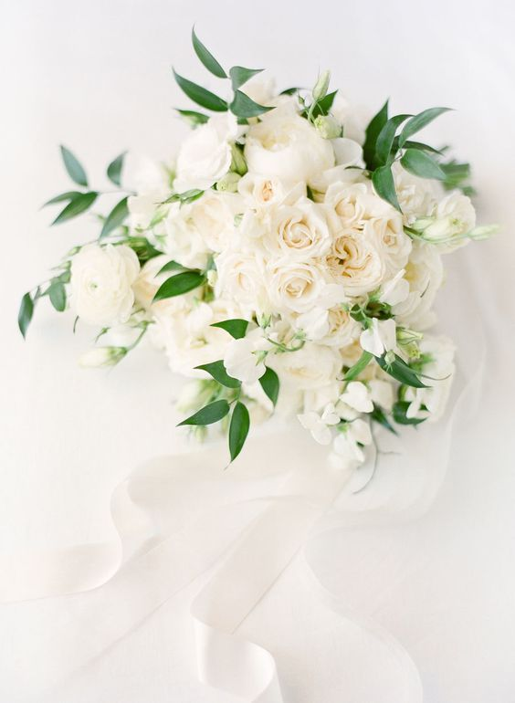 white roses and peonies bouquet with greenery