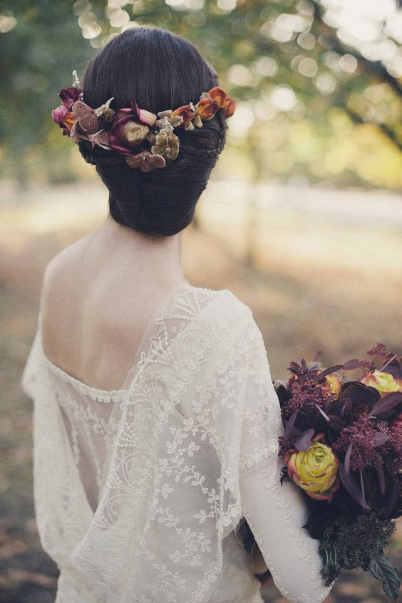 sleek updo with a moody orchid crown